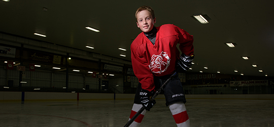 child in hockey gear